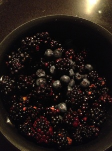 Blueberries and blackberries in the sauce pan