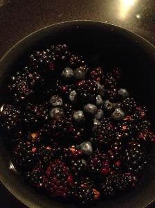 Blueberries and blackberries in the sauce pan