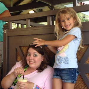 Hailey tried to get my tiara at the Dole Whip meet up.