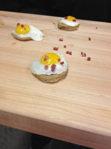 Buckwheat pancake with sunny side up quail egg and salami